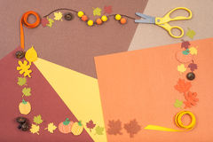Colorful accessories for autumn craft arranged in a frame Stock Photography