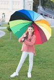 Colorful accessory for cheerful mood. Girl child long hair walking park with umbrella. Stay positive and optimistic. Colorful accessory positive influence royalty free stock photo