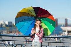 Colorful accessory for cheerful mood. She likes bright accessories. Umbrella for kid. Hiding from problems. Positive and. Bright. Girl cute child standing with stock photography