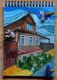 Colorful acrylic drawing of country house. Sketchbook with cornflowers on drawing.  Stock Image