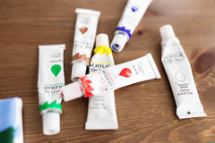 Colorful acrylic paints. In tubes royalty free stock photos