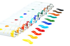 Colorful acrylic paints in tubes on the white background. Colorful acrylic paints in tubes on white background royalty free stock images