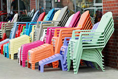 Colorful Adirondack Chairs. Row of multi-colored Adirondack chairs Royalty Free Stock Images