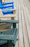 Colorful Adirondack deck and beach chairs in bright blue beige a Stock Images