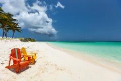 Colorful adirondack lounge chairs at Caribbean beach Stock Image