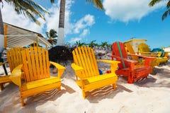 Colorful adirondack lounge chairs at Caribbean beach Stock Photo
