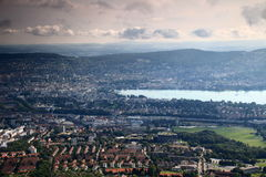 Colorful aerial cityscape of Zurich and Lake Zurich. Cityscape of Zurich, the colorful rooftops of the city centre with Lake Zurich and Adlisberg, seen from Stock Photos