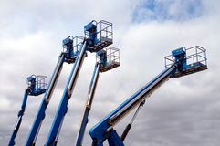 Colorful Aerial Lift. Group of colorful aerial lifts reaching up into the sky Royalty Free Stock Photo