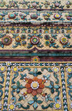 Colorful aged flower ceramic tile decoration at buddhist temple Stock Photos