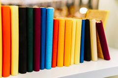 Colorful Agenda Books In A Row On Shelf Royalty Free Stock Image