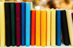 Colorful Agenda Books In A Row On Shelf Stock Photo