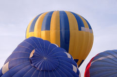 Colorful air balloon flies high in the sky.  stock images