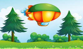 A colorful aircarft above the hill Stock Photography