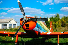 Colorful airplane parked on the grass at the airfield Royalty Free Stock Photo