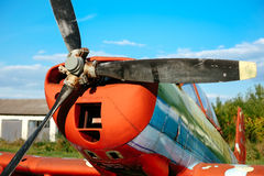 Colorful airplane parked on the grass at the airfield Stock Photos