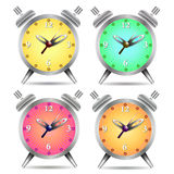 Colorful alarm clock isolated on white background Royalty Free Stock Photos