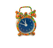 Colorful alarm clock on white with clipping path. Stock Photos
