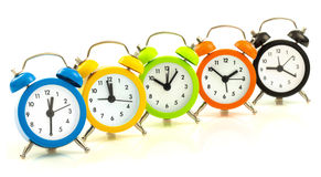 Colorful alarm clocks, align Royalty Free Stock Photography