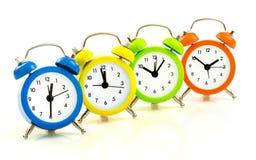 Colorful alarm clocks Stock Photo