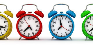 Colorful alarm clocks in a row Royalty Free Stock Photos