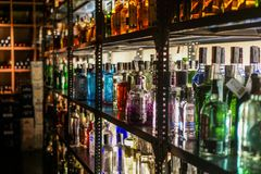 Colorful alcohol bottles in bar Stock Images
