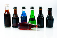 Colorful Alcohol small bottles. On a white background Royalty Free Stock Photos