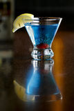 Colorful Alcoholic Cocktail. A colorful beverage served on a marble restaurant bar Stock Photo