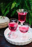 Colorful alcoholic cocktails in beautiful vintage glassware. On a wooden table stock images