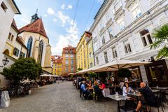 Colorful alley in Graz travel spot. Graz, Styria / Austria - 07 09 2016 : One of colorful alleys in Graz city with historical buildings church and restaurants royalty free stock images