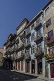 Colorful alley in Porto, Portugal. Porto, Portugal - August 2014: Streets of Porto with typical small houses in the city center royalty free stock image