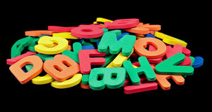 Colorful Alphabet. A pile of colorful foam letters isolated on black Royalty Free Stock Image