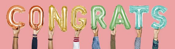 Colorful alphabet balloons forming the word congrats royalty free stock photography