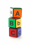 Colorful alphabet blocks. Stacked on white background Stock Photography