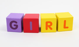 Colorful alphabet cubes. Word girl written with colorful alphabet cubes Royalty Free Stock Photo