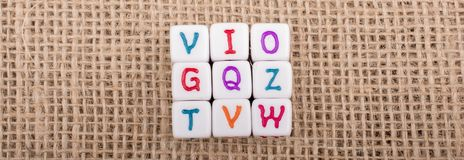 Colorful alphabet letter cubes on a canvas. Colorful alphabet letter cubes on a linen canvas Royalty Free Stock Photo