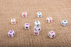 Colorful alphabet letter cubes on a canvas Stock Photo