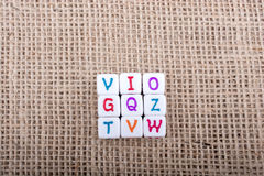 Colorful alphabet letter cubes on a canvas Royalty Free Stock Image