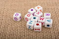 Colorful alphabet letter cubes on a canvas Royalty Free Stock Photos