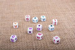 Colorful alphabet letter cubes on a canvas Royalty Free Stock Images