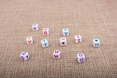 Colorful alphabet letter cubes on a canvas Royalty Free Stock Photo