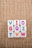 Colorful alphabet letter cubes on a canvas Royalty Free Stock Photography