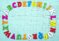 Colorful alphabet letters on light blue background Royalty Free Stock Image