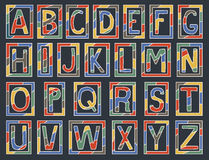 Colorful alphabet letters with frames on dark Stock Images