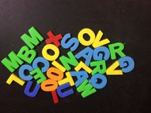 Colorful alphabet letters toy. Ncolorful letters playing on black background Stock Image