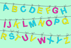 Colorful alphabet letters. Vector hanging colorful alphabet letters on a rope Royalty Free Stock Photo