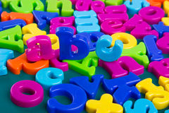 Colorful Alphabet. Magnetic letters on green background Stock Image