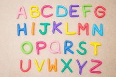 Colorful alphabet a to z. On brown background royalty free stock image