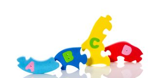Colorful alphabetic puzzle lettres Stock Photos