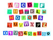 Colorfur newspaper alphabeth and number. Colorful alphabets , numbers and some signs and symbols cut out in newspaper isolated on a white background Stock Photo