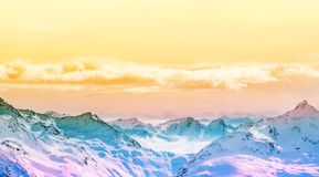 Colorful Alpine panorama. Snow covered mountain peaks. The horizon and beautiful clouds Stock Photography